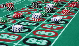 Roulette Table with Chips. Roulette table with multi-colored chips royalty free stock photos
