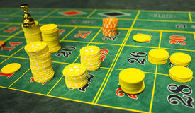 Roulette table chips. In a casino. Closed up of casino roulette gambling table game. Yellow and orange chips stock photos