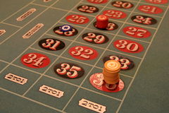 Roulette table with chips on 36 Royalty Free Stock Images