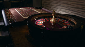 Roulette table. Detail of a green roulette table with some numbers Stock Photo