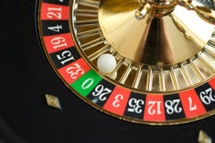 Roulette wheel. And white plastic ball closeup royalty free stock photography