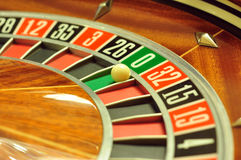 Roulette wheel. Image with a casino roulette wheel with the ball on number 0 stock photos