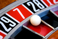 Roulette wheel. With ball on 7 royalty free stock images