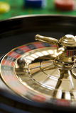 Roulette wheel. Spinning roulette wheel with ball and gambling chips royalty free stock photo