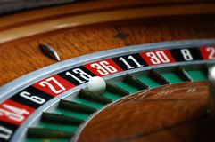 Roulette wheel. With ball in thirteen slot royalty free stock photo