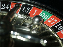 Roulette wheel. Casino roulette wheel with steel ball landing on 00 royalty free stock photos