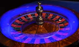 Roulette wheel with blue light streak stock images