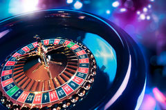 Roulette wheel with a bright and colorful background Royalty Free Stock Image