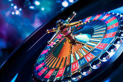Roulette wheel with a bright and colorful background Royalty Free Stock Photos