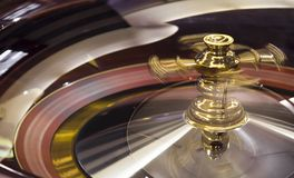 Roulette wheel close up. Spinning roulette wheel close up royalty free stock photo