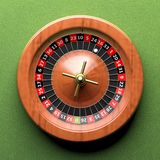 Roulette wheel. Close-up of roulette wheel on green background.From above stock illustration