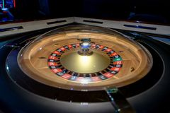 Roulette wheel in a dark casino Stock Photos