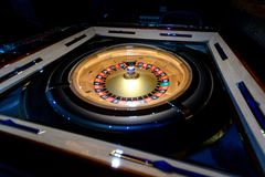 Roulette wheel in a dark casino Stock Images