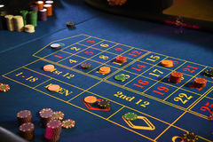 Roulette wheel gambling. Gambling at the roulette wheel royalty free stock image
