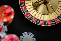 Roulette wheel gambling in a casino. Roulette wheel gambling in a casino table stock photo