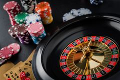 Roulette wheel gambling in a casino table. Roulette wheel gambling in a casino table close up stock image
