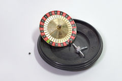 Roulette wheel, jumped down from gambling table Royalty Free Stock Image