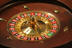 Roulette Wheel in Motion. Spinning roulette wheel in a casino Stock Photo