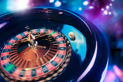 Roulette wheel in motion with a bright and colorful background Stock Photography
