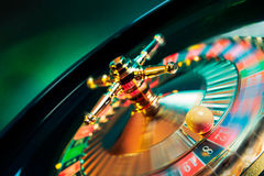 Roulette wheel in motion with a bright and colorful background Royalty Free Stock Photography