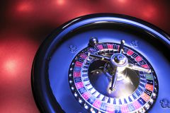 Roulette Wheel. On Red Background royalty free stock photo