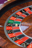 Roulette wheel stopping. And ball landing on black 26 stock photo