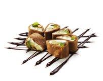 Roulis de sushi de chocolat photo stock