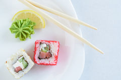 Roulis de sushi de plaque Photo stock