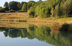 Roumazieres Loubert, Lake and Woodland stock photography