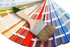 Round. Paint brush placed on the color chart royalty free stock images