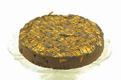 Round almond chocolate cake isolated. Stock Photography