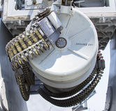 Round of ammunition loaded into .50-caliber machine gun on US Navy destroyer  during Fleet Week 2012 Royalty Free Stock Image