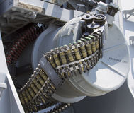 Round of ammunition loaded into  50-caliber machine gun on US Navy destroyer during Fleet Week 2012 Stock Photography