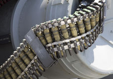 Round of ammunition loaded into  50-caliber machine gun on US Navy destroyer Stock Photography