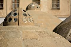 Round ancient roofs of public baths in Baku Old City, within the capital of Azerbaijan Stock Images