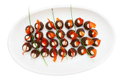 Round appetizers on plate shot from above Royalty Free Stock Image