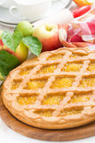 Round apple pie on a white wooden table Royalty Free Stock Photos