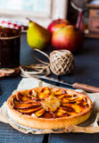 Round apple tart with pear jam and caramel, vertically Stock Images