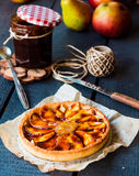 Round apple tart with pear jam and caramel, vertically Royalty Free Stock Photo