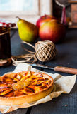 Round apple tart with pear jam and caramel, vertically Royalty Free Stock Photography