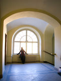 Round arch and a window. Inside old house and a girl near the window Stock Image