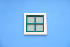 Round arch window on the blue wall Royalty Free Stock Photography