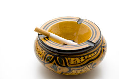 Round ashtray with cigarette Royalty Free Stock Photography