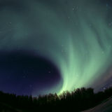 Round aurora rolling out. Northern lights rolling out on the sky Royalty Free Stock Image