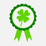 Round award with clover leaf and ribbons. Happy Pa Stock Photos