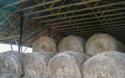 Round bales of hay in wooden barn Royalty Free Stock Photos