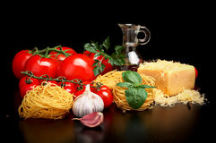 Round balls of pasta with cheese,tomatoes,basil,olive oil on black Stock Photography