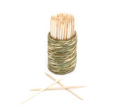 A round bamboo box of toothpicks. Ioslate on white background Royalty Free Stock Images