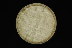 Round bamboo plate isolated on black background stock photo