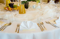 Round banquet table. Round decorated banquet table in white royalty free stock images